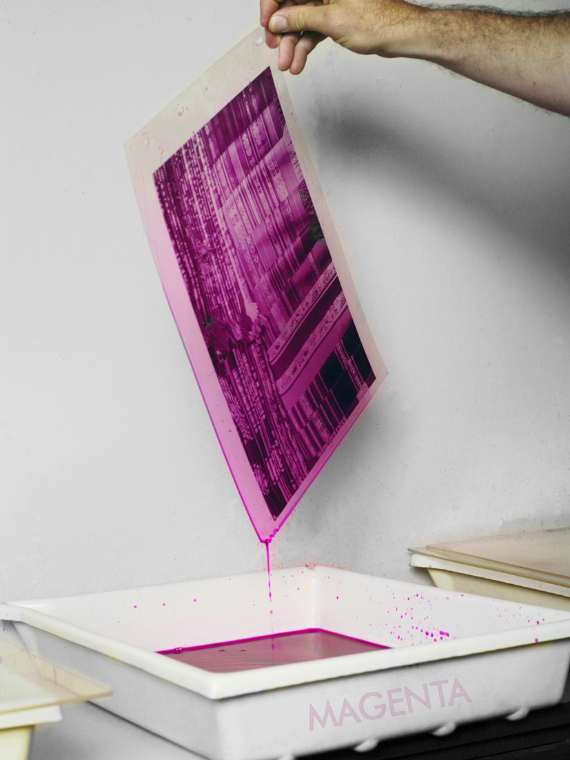 Image: Andy Cross. Draining excess magenta dye from a matrix printer prior to transferring